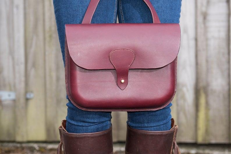 Hand stitched leather shoulder bag